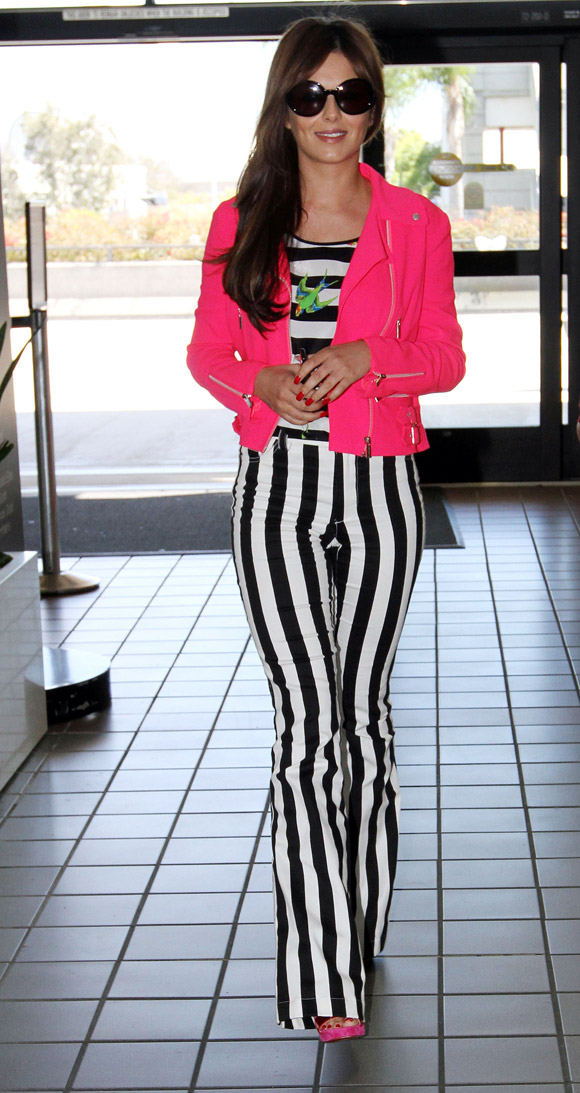 Cheryl Cole wearing statement trousers