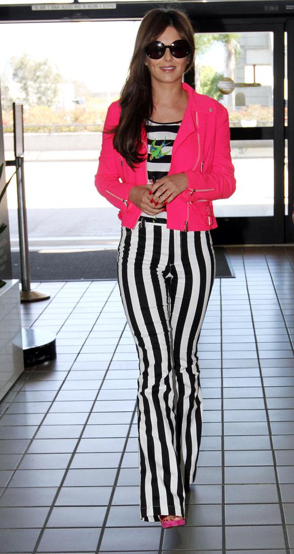 Cheryl Cole wearing statement trousers