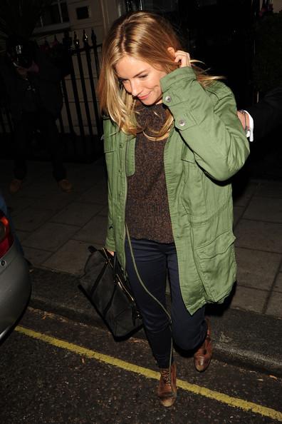 Sienna Miller wearing army jacket