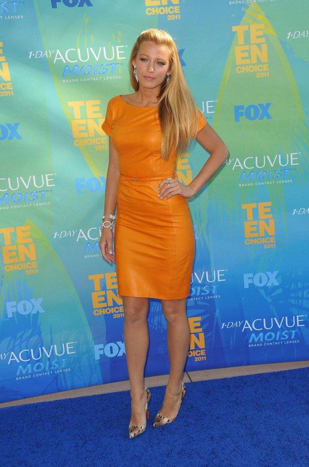 Blake Lively in orange leather dress