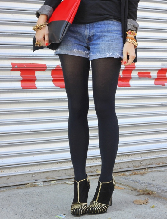 I wore black fleece lined leggings and faded jean shorts once when I was on holiday in a colder place and ran out of jeans. I had a grey tank and navy blue leather aviator jacket on top and I wore black and white Nike sneakers with leopard print.