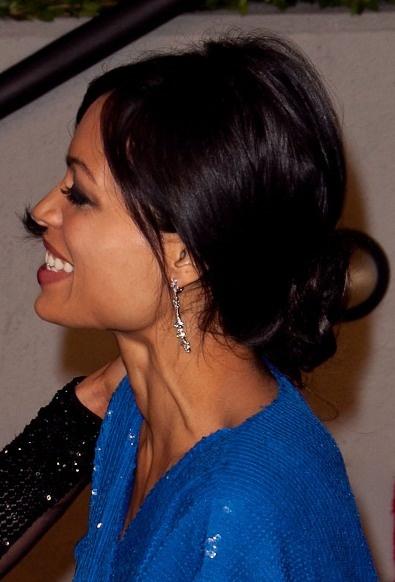 rosario-dawson-loose-bun-hairstyle